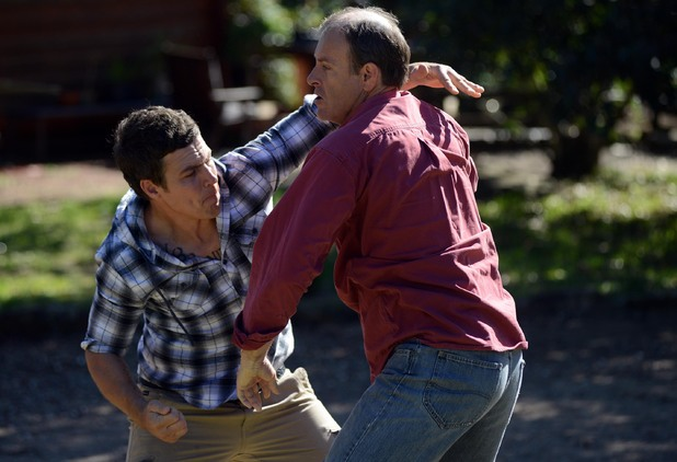 Brax punches Murray.