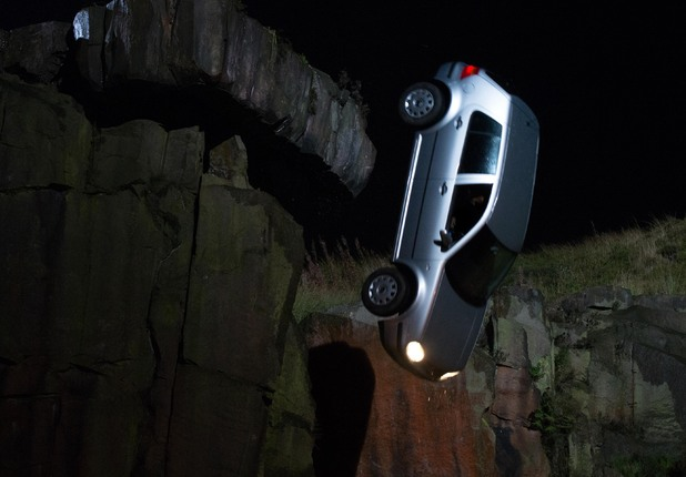 The car goes over the cliff.