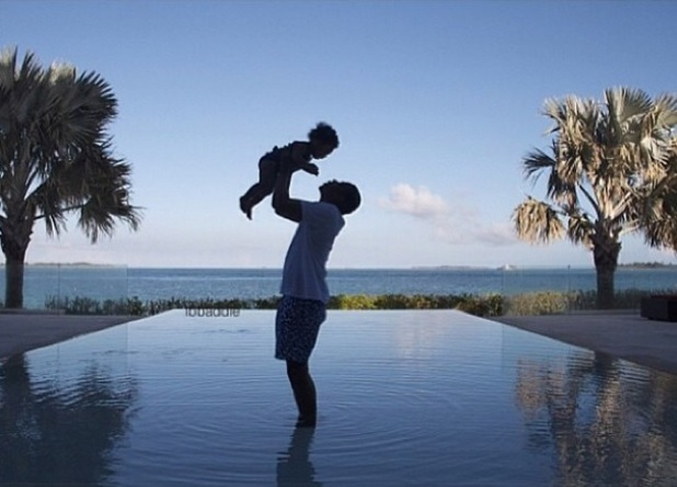 Jay Z holding baby Blue Ivy aloft on holiday