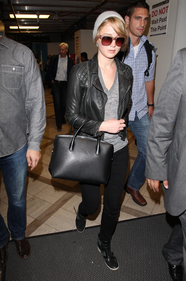 Jennifer Lawrence arrives at Los Angeles International Airport