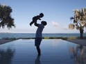 Jay Z holds baby Blue Ivy aloft in a Lion King-style pose.