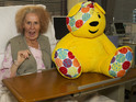 The actress's Nan character visits the hospital for Children in Need.