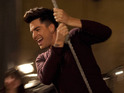Adam Lambert and Chris Colfer appear in a behind-the-scenes clip from Glee.