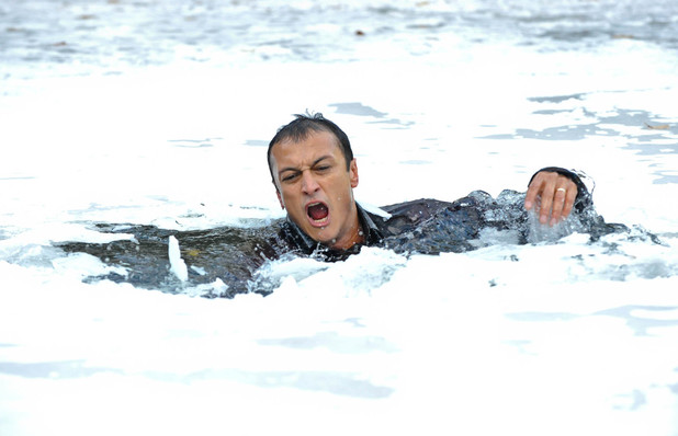 Jai plunges into the frozen waters.