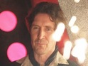 The actor plays the eighth Doctor on-screen for first time since 1996 in new mini-episode.