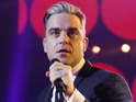 Robbie Williams is reportedly undecided over whether to help pen the album.