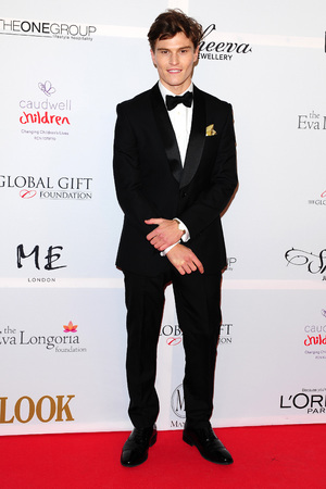 Oliver Cheshire attending the Eva Longoria Global Gift Gala at ME London in central London.
