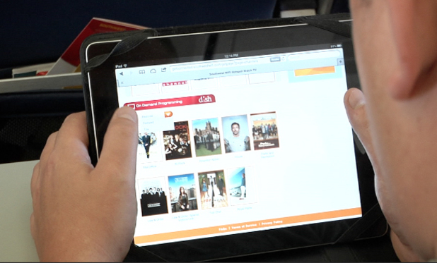 Southwest Airlines customer using a tablet with live and on-demand TV via its Wi-Fi service