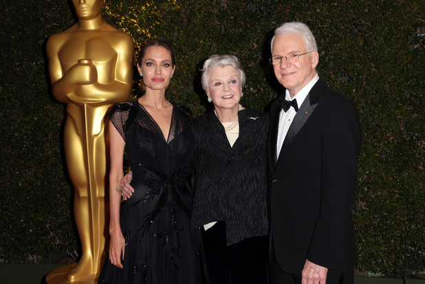 Angela Lansbury (C), Angelina Jolie (L) and Steve Martin (R) arrive for the 2013 Governors Awards, presented by the American Academy of Motion Picture Arts and Sciences (AMPAS), at the Grand Ballroom of the Hollywood and Highland Center in Hollywood, California, November 16, 2013