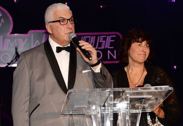 Mitch Winehouse, standing next to Amy's mother Janis, at the ball