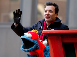 Jimmy Fallon and Cookie Monster at the 87th annual Macy's Thanksgiving Day parade on November 28, 2013 in New York City