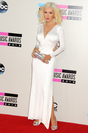Christina Aguilera arrives at the American Music Awards at the Nokia Theatre L.A. Live on Sunday, Nov. 24, 2013, in Los Angeles