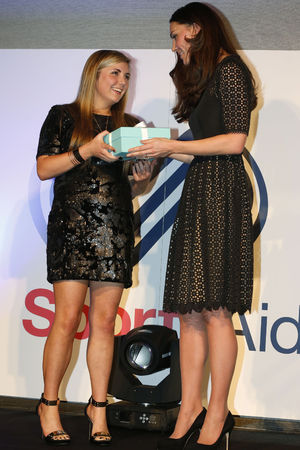 The Duchess of Cambridge (right)presents the charity's this year One-to-Watch Award to shooter Amber Hill, 16 (left) during the the SportsAid SportsBall gala dinner at Supernova, Embankment Gardens, London.
