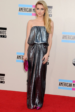 Emma Roberts arrives at the American Music Awards at the Nokia Theatre L.A. Live on Sunday, Nov. 24, 2013, in Los Angeles