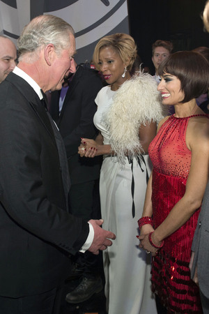 The Prince of Wales speaks with Mary J Blige (second right) and Flavia Cacace (right) during the Royal Variety Performance, at the London Palladium, in central London.
