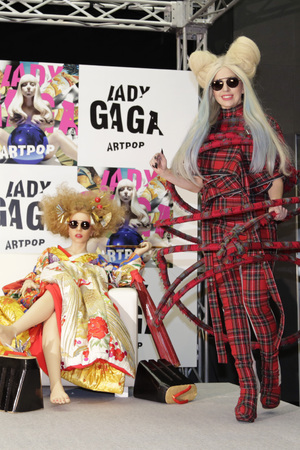 "Lady Gaga poses for photographers with her life-sized doll during a press conference to promote her album ""ARTPOP"" in Tokyo"