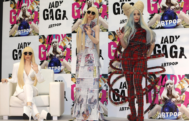 "Lady Gaga poses for photographers with her life-sized dolls during a press conference to promote her album ""ARTPOP"" in Tokyo"