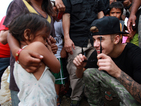 Justin Bieber visits Philippines, raises funds for typhoon victims
