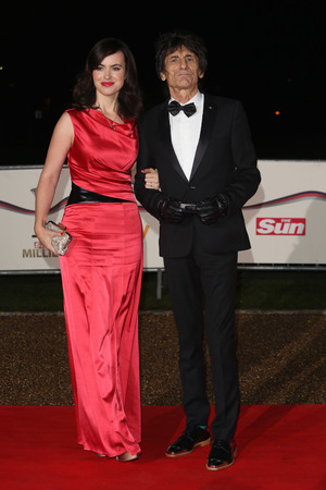 Ronnie Wood and Sally Humphreys The Sun Military Awards 2013, London, Britain - 11 Dec 2013