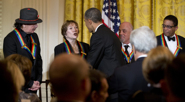 President Obama congratulates Shirley MacLaine at the Kennedy Center Honors in the East Room of the White House