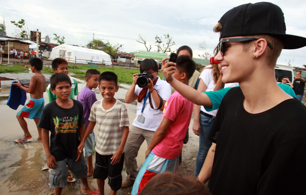 Justin Bieber visits the Philippines where locals have been left devastated by Typhoon Haiyan