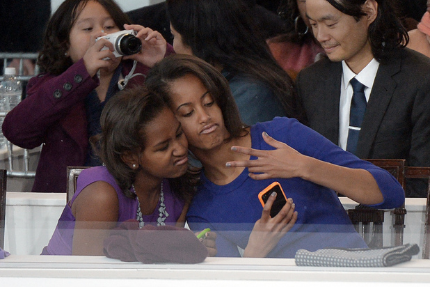 Sasha and Malia Obama take a photo of themselves at their father Barack Obama's second presidential inauguration, January 21 2013
