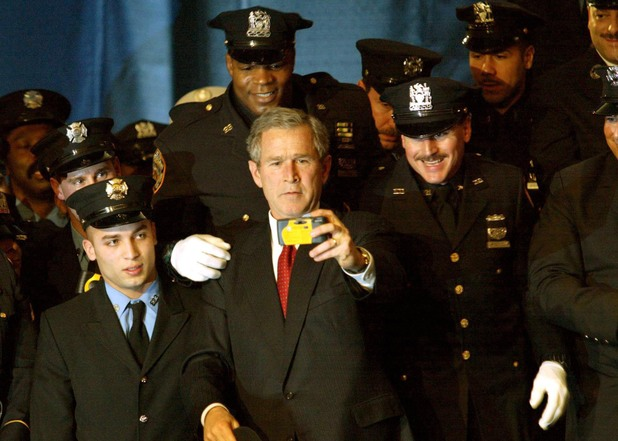 GEORGE W BUSH MAKING A SPEECH AT NEW YORK LAW ENFORCEMENT GROUPS, MIDTOWN SHERATON, AMERICA - 06 FEB 2002 George W Bush posing for a photograph with the NYPD.