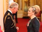 Adele officially appointed MBE by Prince Charles at Buckingham Palace
