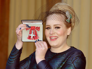 Adele receives her MBE from the Prince of Wales at Buckingham Palace, December 19, 2013