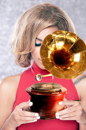 Lewis Lewis holding a gramophone
