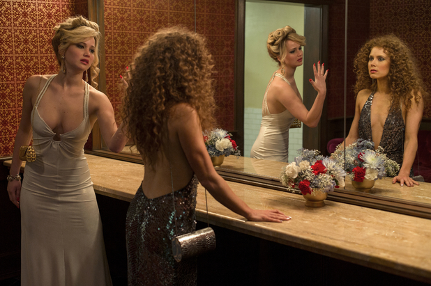 Jennifer Lawrence, Amy Adams in American Hustle