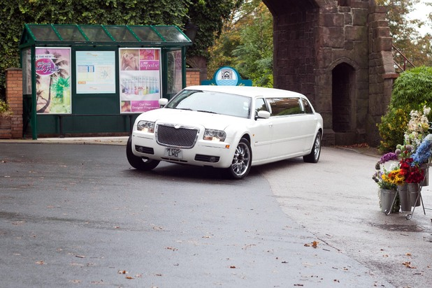 A limo pulls up in the village