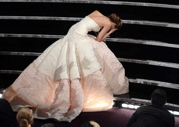 HOLLYWOOD, CA - FEBRUARY 24: Actress Jennifer Lawrence reacts after winning the Best Actress award for 'Silver Linings Playbook' during the Oscars held at the Dolby Theatre on February 24, 2013 in Hollywood, California. (Photo by Kevin Winter/Getty Images)