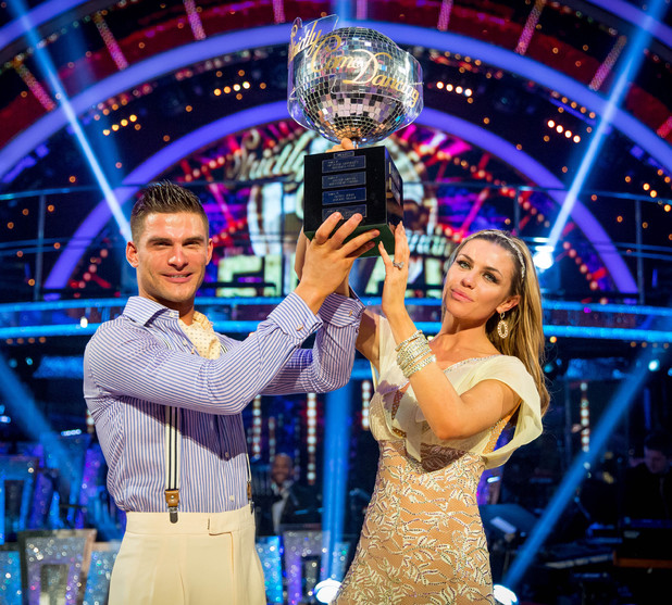 Abbey and Aljaz lift the trophy