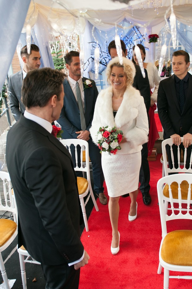 Sandy walks down the aisle