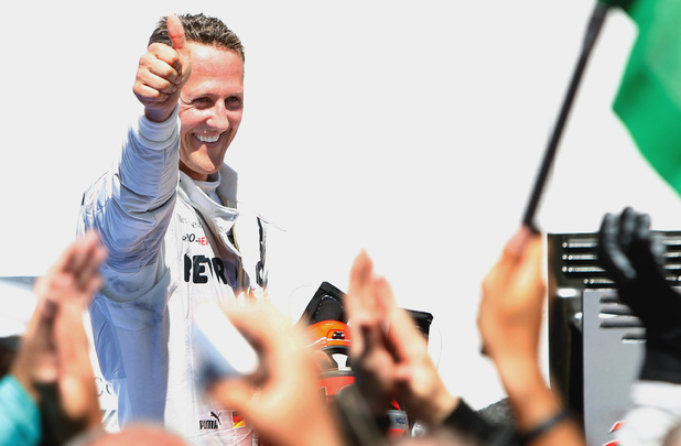 Mercedes Formula One driver Michael Schumacher, from Germany, celebrates his third position after the European Formula One Grand Prix at Valencia street circuit, Spain, Sunday, June 24, 2012.
