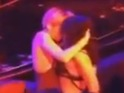 Concertgoer catches the moment the singer shares an embrace with a female dancer.