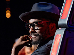 will.i.am smiles during The Voice UK's third series premiere