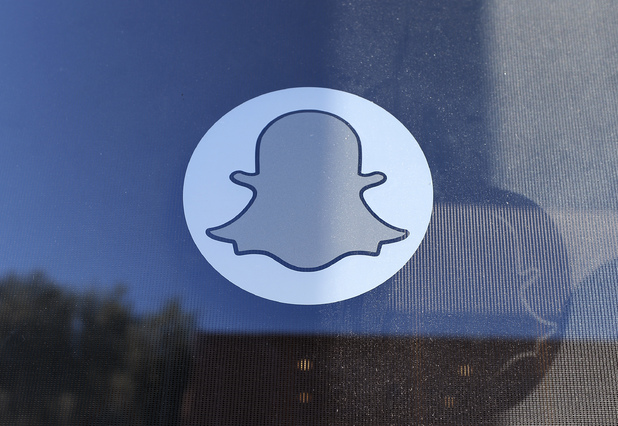 The logo of Snapchat is seen at the front entrance of their headquarters