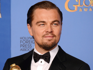 Leonardo DiCaprio with a Golden Globe award