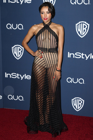 Kat Graham arrives at the 15th annual InStyle and Warner Bros. Golden Globes after party at the Beverly Hilton Hotel on Sunday, Jan. 12, 2014, in Beverly Hills, Calif.