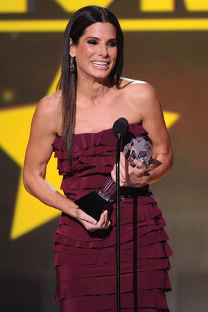 "Sandra Bullock accepts the award for best actress in an action movie for ""Gravity"" at the 19th annual Critics' Choice Movie Awards"