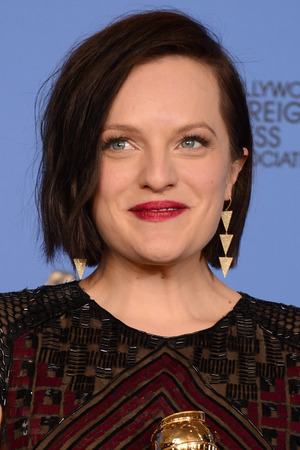 Elisabeth Moss with a Golden Globe award