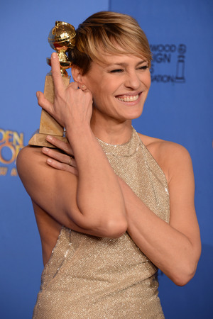Robin Wright with a Golden Globe award