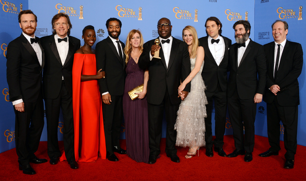"Michael Fassbender, Bill Pohlad, Lupita Nyong'o, Chiwetel Ejiofor, Dede Gardner, Steve McQueen, Sarah Paulson, Jeremy Kleiner, Anthony Katagas and Hans Zimmer pose in the press room with the award for best motion picture - drama for ""12 Years a Slave"" at the 71st annual Golden Globe Awards"