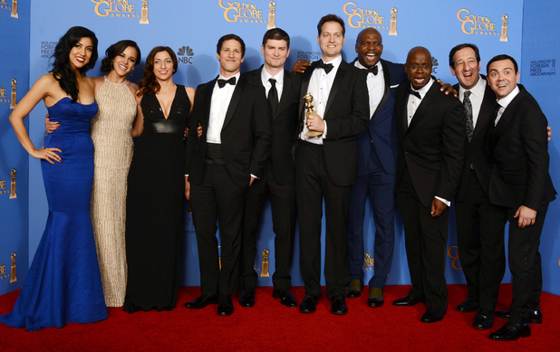 Brooklyn Nine-Nine cast with a Golden Globe award