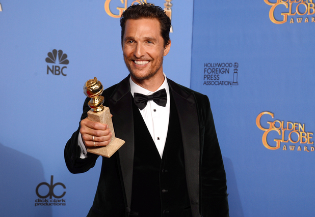 "Matthew McConaughey poses in the press room with the award for best actor in a motion picture - drama for ""Dallas Buyers Club"" at the 71st annual Golden Globe Awards"