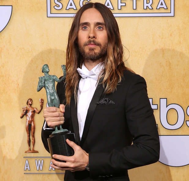 "Jared Leto poses in the press room with the award for outstanding performance by a male actor in a supporting role for ""Dallas Buyers Club"""