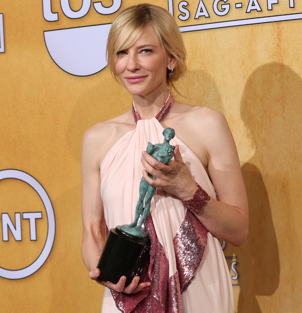 Cate Blanchett poses in the press room with the award for outstanding performance by a female actor in a leading role for Blue Jasmine