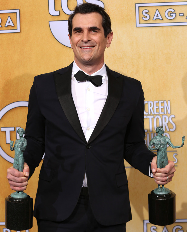 "Ty Burrell poses with the award for outstanding performance by an ensemble in a comedy series for ""Modern Family"""